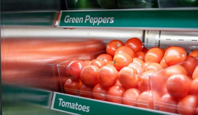 Tomatoes in a case at Subway.