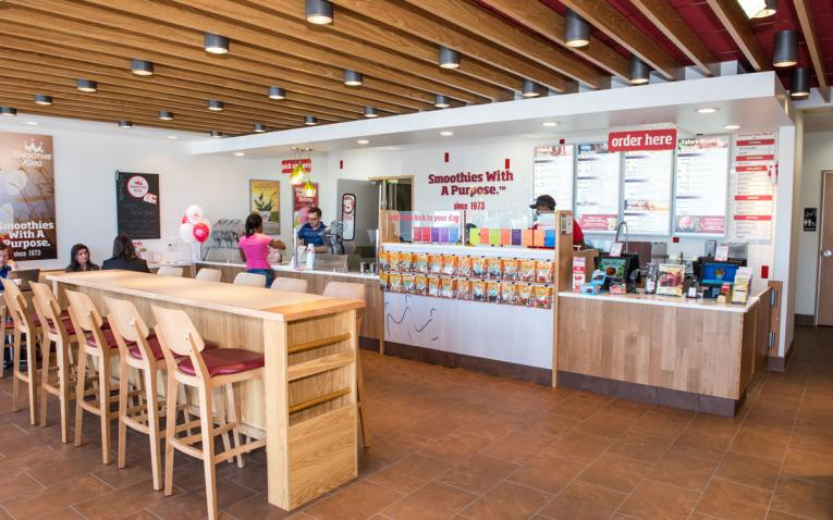 Inside a Smoothie King, where guests are being served.