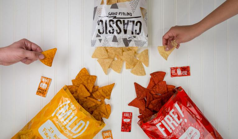 Taco Bell tortilla chips spice up stores nationwide, giving fans a new way to enjoy the brand's iconic flavors.