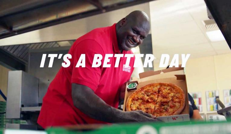 Shaquille O'Neal holding a Papa John's pizza