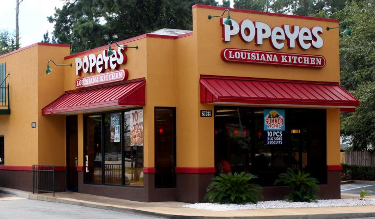 Popeyes restaurant with drive thru.