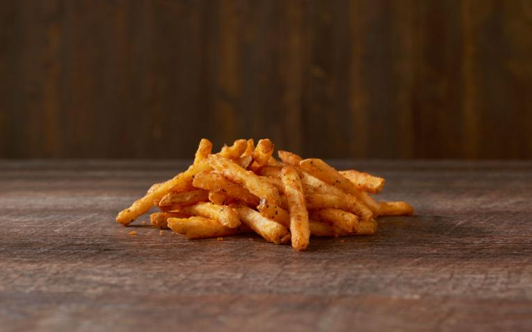 Checkers fries on a table.