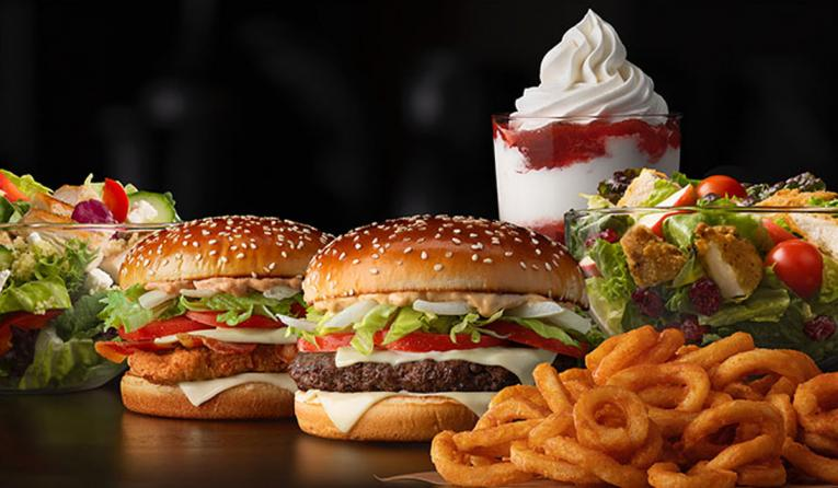 Two burgers, salad, dessert, and fries at McDonald's.