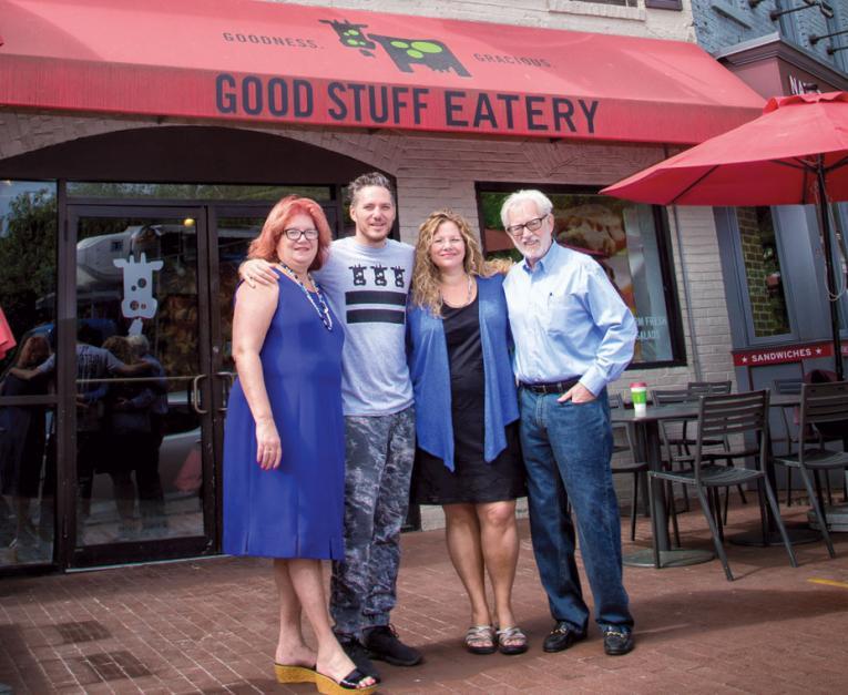 Spike and Micheline Mendelsohn (center) run three Washington D.C.–based restaurants with their parents, Catherine (left) and Harvey Mendelsohn (right).