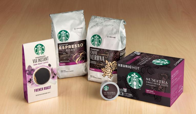 Packages of Starbucks coffee on a table.
