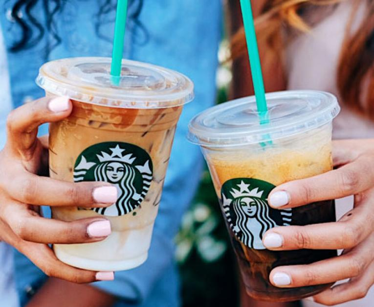 Starbucks baristas toast espresso drinks. The coffee chain just announced raises for employees.