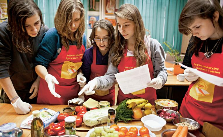 Teenagers in Poland learn to cook balanced meals through a nationwide education programme called 'Eat Tasty and Healthy.'
