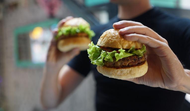 Man holding a slider burger.