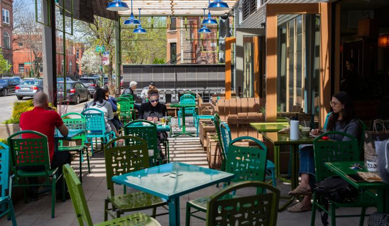 Customers sit outside at Colectivo coffee restaurant.