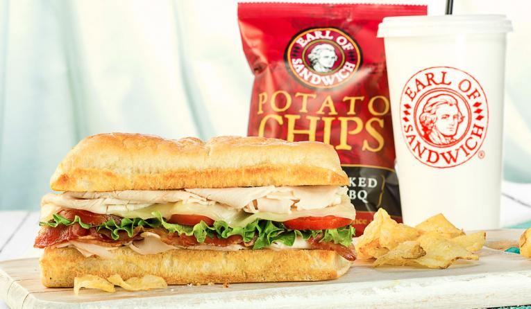 A sandwich, drink, and fries at Earl of Sandwich fast casual restaurant.
