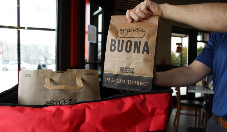 A bag of Buona food is prepared for delivery.