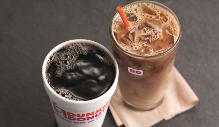 A cup of hot coffe and iced coffee side by side from Dunkin'.