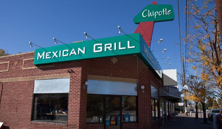 Chipotle restaurant in Colorado with green sign.