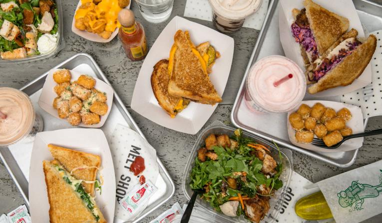 Table full of grilled cheese sandwiches at Melt Shop.