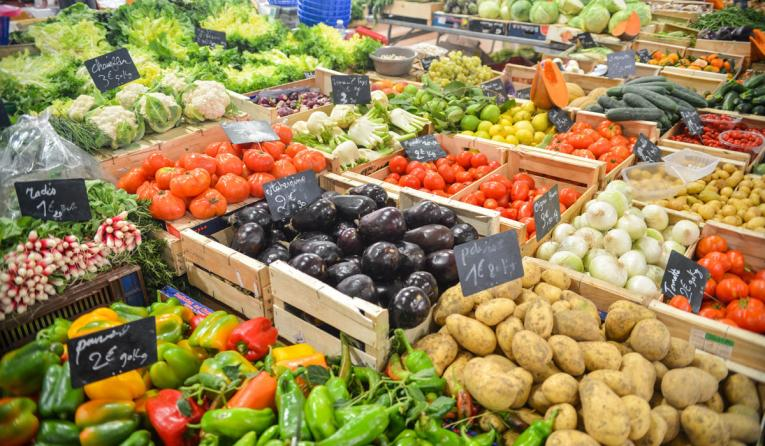 Vegetables in crates at a market.