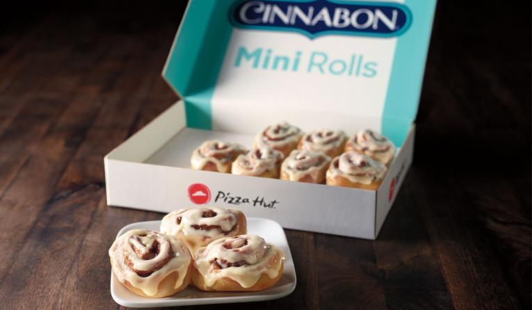 Miniature cinnamon rolls made with Cinnabon Makara cinnamon swirls, topped with Cinnabon signature cream cheese frosting.