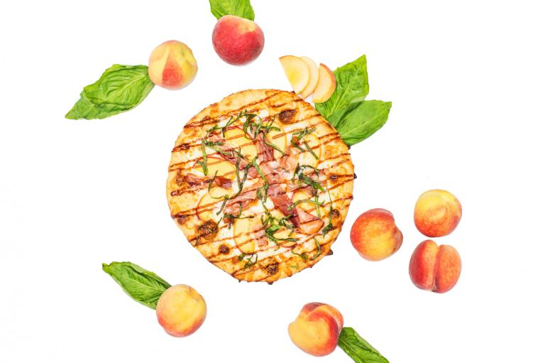 The Peach Prosciutto Pie from Your Pie is a signature pizza option.
