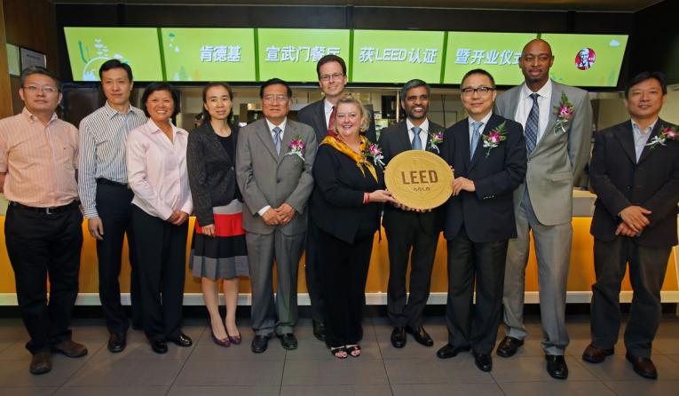 Here, a ceremony  recognizes a LEED-certified unit in Beijing.