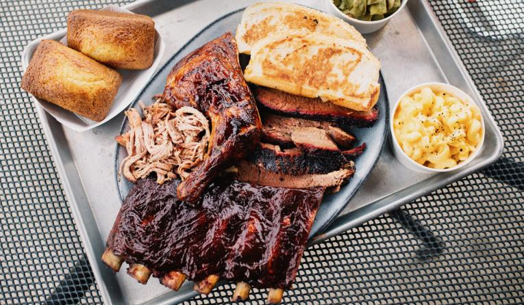 Sampler platter of ribs and barbecue at City Barbecue restaurant chain.