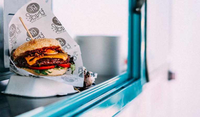 Hamburger on the window of a food truck.