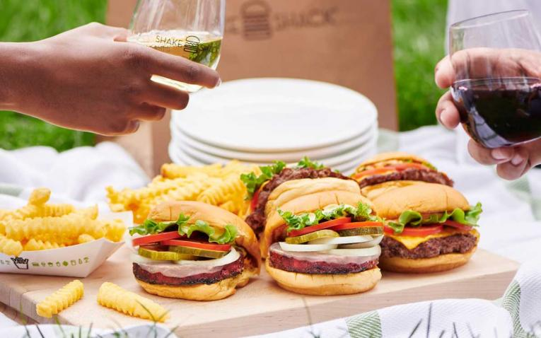 Shake Shack burgers and glasses of wine.