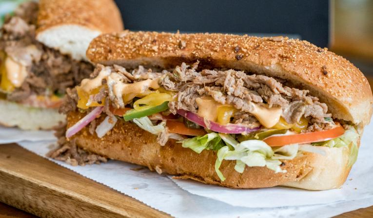 Subway's Chipotle Cheesesteak made with steak, shredded Monterey cheddar cheese, crisp lettuce, sliced tomatoes, green peppers, red onion and jalapeños and dressed with a smoky Chipotle Southwest sauce.