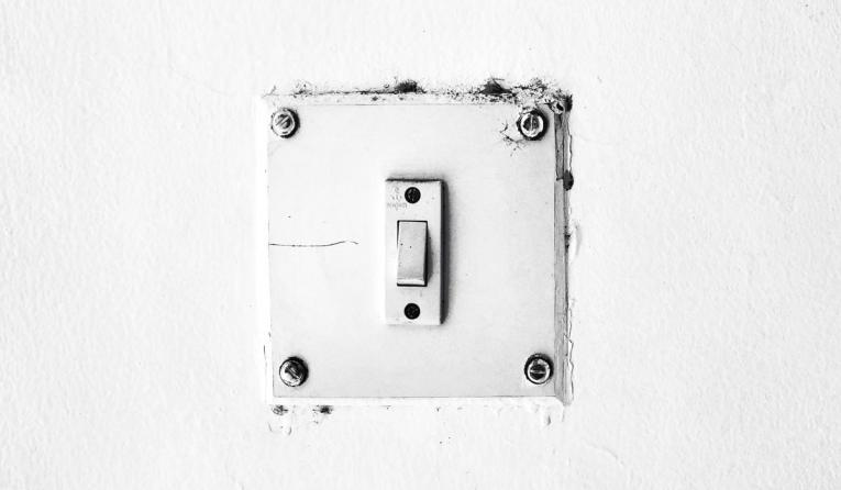 White light switch on a white wall.