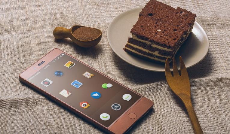 Phone with apps next to a slice of cake.