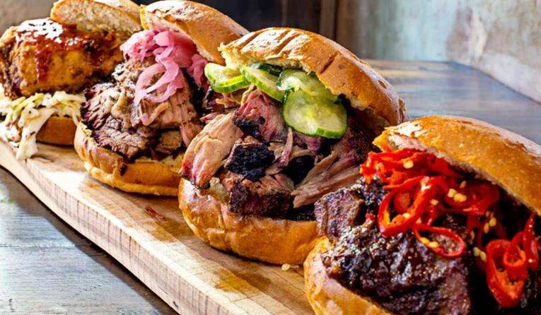 A row of pork sandwiches at Mighty Quinn's Barbeque restaurant.
