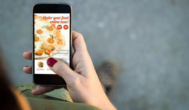 A person orders pizza from their phone.