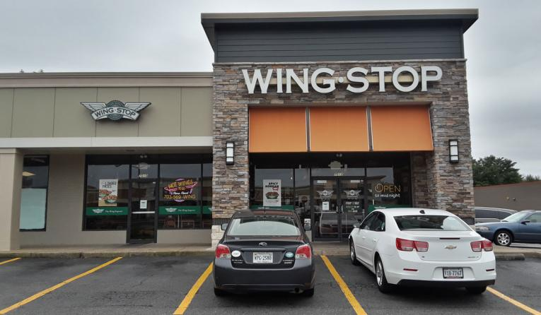 The exterior of a Wingstop restaurant.