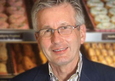Dunkin' Brands CEO Nigel Travis wants to take Dunkin' Donuts from a New England