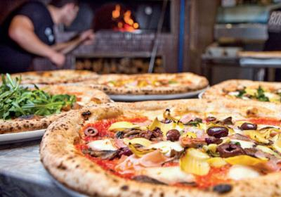 Quick service pizza brands innovate with menu using on trend toppings.