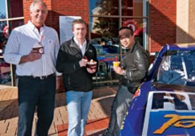 Red Mango partnered with NASCAR drive Bobby Labonte (center) as franchisee.