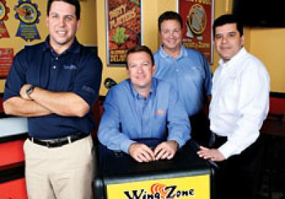 Wing Zone's Matt Friedman, Adam Scott, Casey McEwen, and Hair Parra.