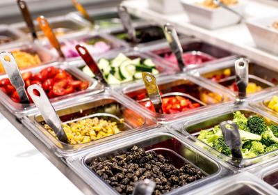 A salad bar filled with choices at Coolgreens.