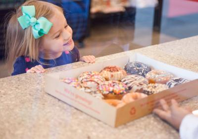 A child orders from the counter at Duck Donuts.