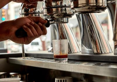 A barista pours a coffee at Saxbys.