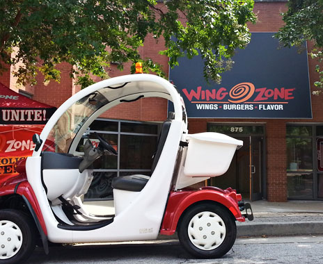 Chicken chain Wing Zone delivers menu items via electric golf cart.