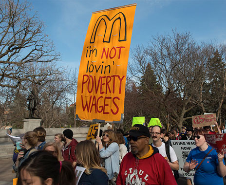 QSR brands fight new regulation to increase minimum wage for fast food restaurants.